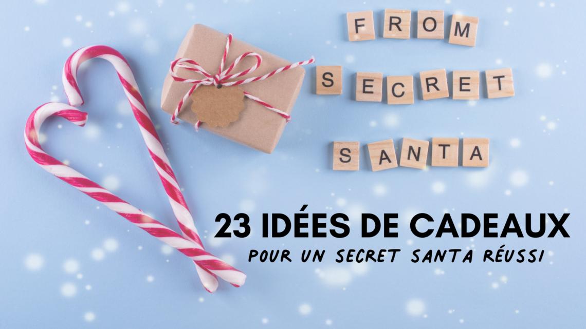 Bonbons candy cane qui forment un coeur à côté d'un petit cadeau emballé et des lettres en bois avec from secret santa