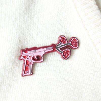 Vêtements & Accessoires - Pin's Pistolet avec des Fleurs